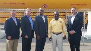 Pictured in front of ABC Student Transportation's 12,000-gallon propane tank, from left: Roush CleanTech's Todd Mouw, Blue Bird's Blue Flame Propane's John Foster, Detroit Public Schools' James Minnick, ABC Student Transportation's Brian Flaggs, and Blue Bird's Ryan Zic