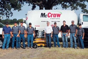 McCraw Oil & Propane employees pose in front of fleet vehicles and equipment that have been converted to propane autogas.