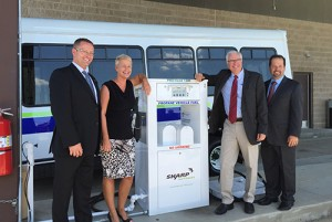 From left: Joe Thompson, president of Roush CleanTech; Jennifer Cohan, Delaware Department of Transportation secretary; Bob Zola, president of Sharp Energy; John Sisson, CEO of Delaware Transit Corp. (DTC). Photo courtesy of Roush CleanTech.