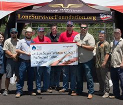 Texas Star Propane team members present a check to the Lone Survivor Foundation. Photo courtesy of Texas Star Propane