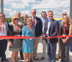 Ray Energy Corp. opened a new rail and truck terminal to distribute propane from its plant in New York, near the border with Vermont. Here, CEO Ken Ray cuts the ribbon to open the terminal. Read more on page 20 about the terminal's capabilities and what it means for propane supply in the Northeast. Photo courtesy of Roger Rosenbaum/brand-news-team