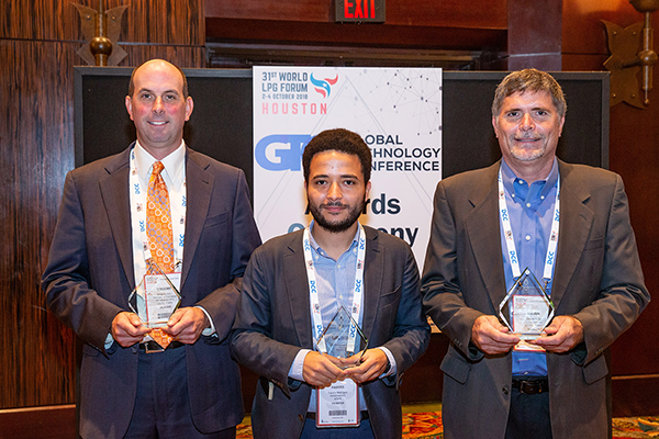 Fausto Marcigot, center, of PayGo Energy (first place); Steve King, right, of Motive Ventures (runner-up); and Greg Kerr of PERC. (Photo courtesy of World LPG Association.)