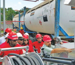 Clark, far right, working in the Caribbean during a bobtail training event. He says working in the propane industry has taken him around the world. Photo courtesy of Tom Clark