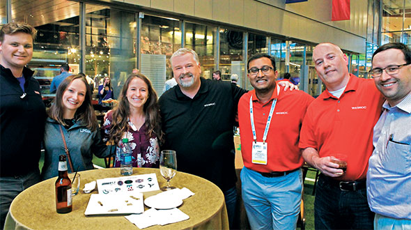 LP Gas team members, from left, Joe McCarthy, Ellen Kriz and Allison Barwacz visit with WESROC Monitoring Solutions' Brad Andersen, Chet Reshamwala and Steve Ingalsbe, as well as Boehlke Bottled Gas' Chad Kroening, during the Young Gassers reception at the College Football Hall of Fame in Atlanta. Photo courtesy of Jason Clark of RegO and the Young Gassers.