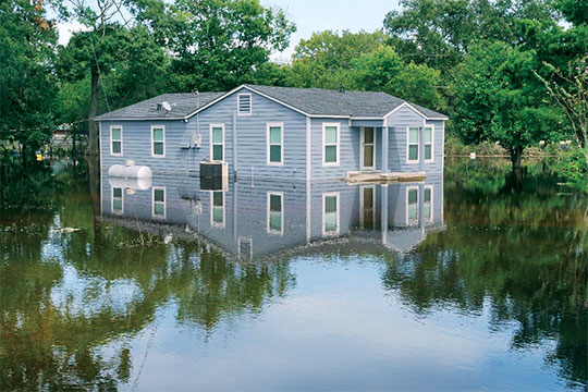 A home propane system, at left, submerged in floodwater. Photo Courtesy of Logica3