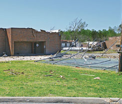 A school with propane tanks damaged by a tornado. Photo courtesy of logica3