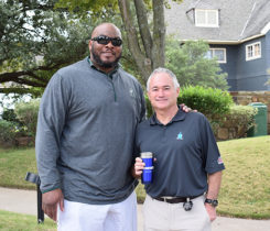 Pros4Care golf benefit photo of former NFL offensive lineman Flozell Adams and Ed Varney of RegO