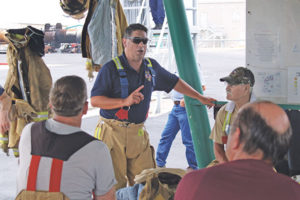Mark Holloway, AmeriGas safety manager and former volunteer fire chief, engaged first responders and LPG pros prior to a live fire training that took place June 2012. Photo by Larry Dombrowski/Logica 3