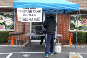 Depew Energy set up a tent outside its office to service customers during the coronavirus pandemic. Photo by Roger Rosenbaum