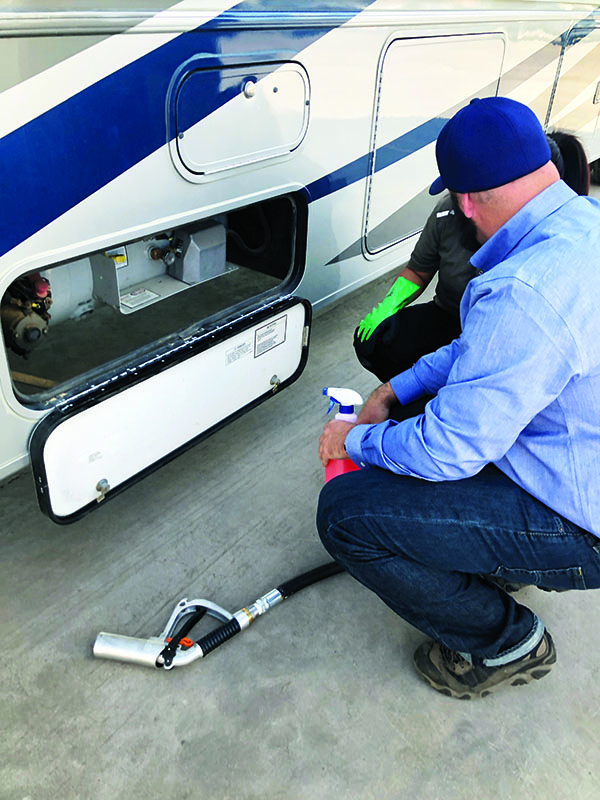 David Kennedy of Alliance AutoGas trains a U-Haul employee on how to fill an RV. Photo courtesy of U-Haul