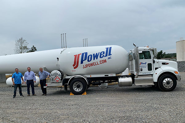 Brandon Duff, operations manager, Doug MacMaster, consultant, and Eric Hussar, director of HVAC sales, pose with one of JJ Powell's bobtails. Photo by Dan Herman