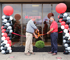 Corrie Eifert, senior general manager of Manchester Tank Quincy (left), and Robert Kotarba, general manager of Manchester Tank Campbellsville, cut the ribbon at the ceremony. Photo: Manchester Tank