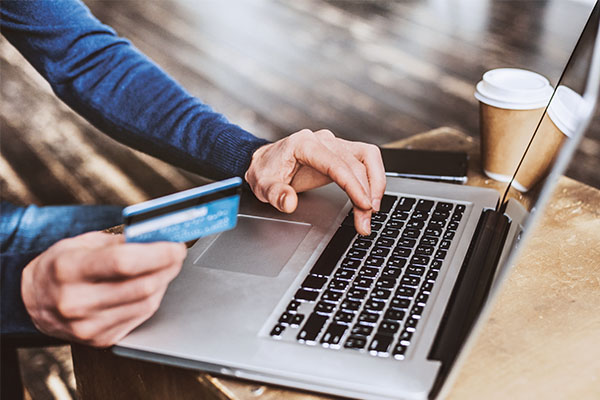 Online shopping is keeping sales of merchandise afloat while many service businesses suffer. Photo: Poike/iStock / Getty Images Plus/Getty Images
