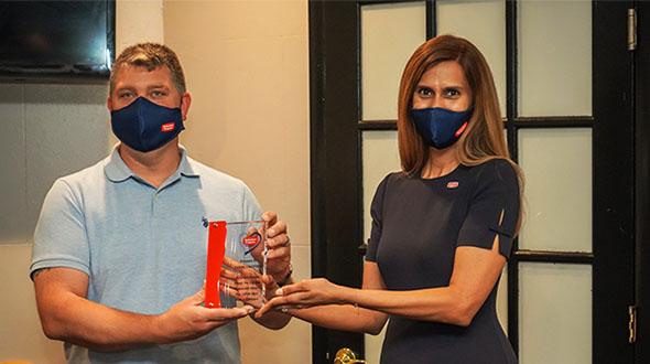 Jason Trotter, operations manager at Suburban Propane's Philadelphia/Telford location, receives the 2020 SuburbanCares Award from Nandini Sankara, spokesperson for Suburban Propane. Photo courtesy of Suburban Propane Partners